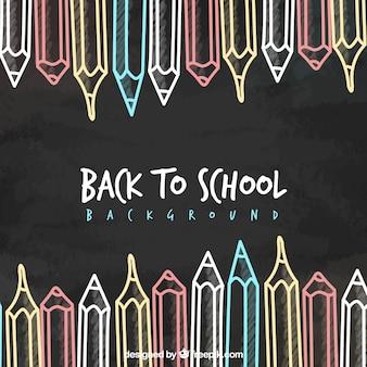 Fondo de vuelta al colegio con lápices dibujados en la pizarra