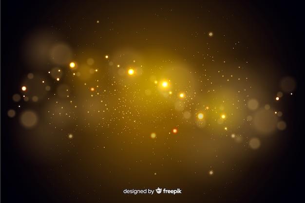 Fondo decorativo de partículas doradas bokeh