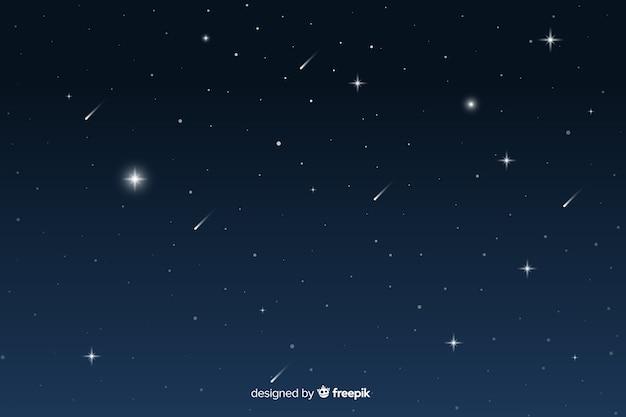 Fondo degradado de noche estrellada con estrellas fugaces