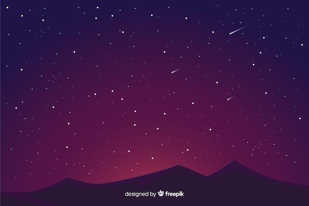Fondo degradado de noche estrellada y montañas