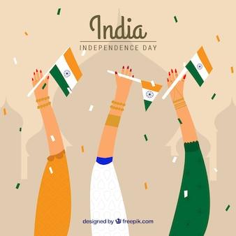 Fondo del día de la independencia de la india con manos sujetando banderas