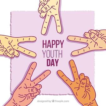 Fondo del día de la juventud con manos