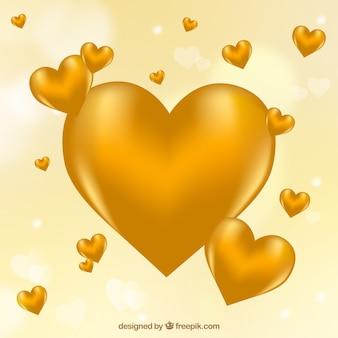 Fondo desenfocado de corazones dorados