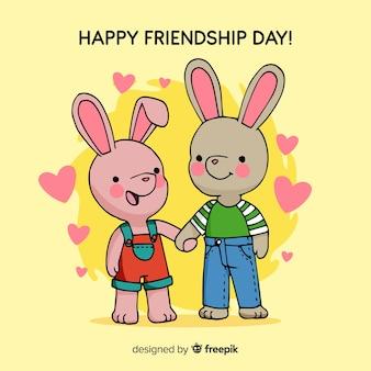 Fondo día de la amistad conejos dibujados a mano