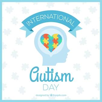 Fondo del día del autismo con corazón de puzzle