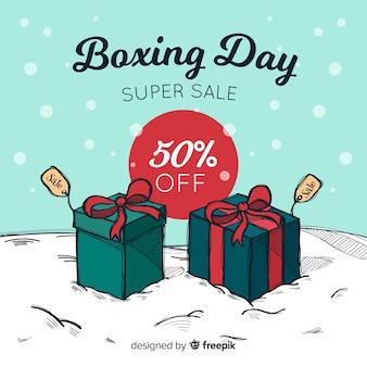 Fondo día del empaquetado regalos sobre la nieve
