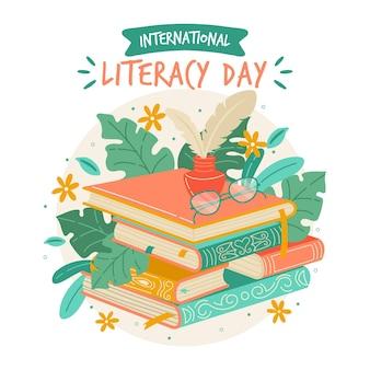 Fondo de día internacional de alfabetización dibujado a mano con libros