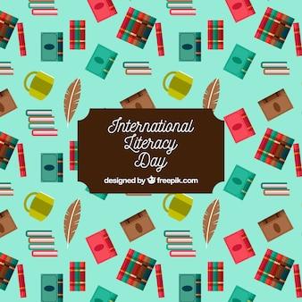 Fondo del día internacional de la alfabetización con elementos en diseño plano