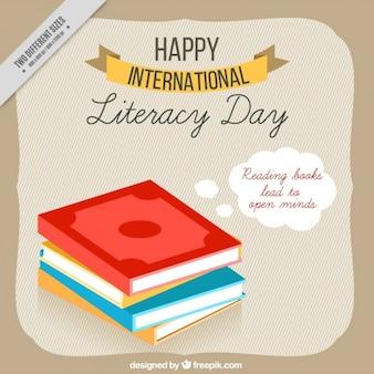 Fondo del día internacional de la alfabetización con libros en diseño plano