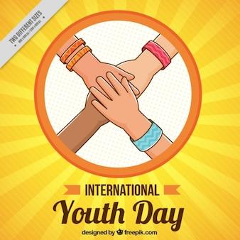 Fondo del día de juventud de bocetos de manos juntas