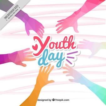 Fondo del día de juventud de manos de colores poligonales