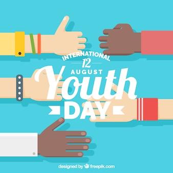 Fondo del día de la juventud con manos en diseño plano