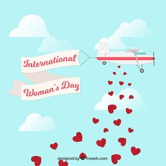 Fondo del día de la mujer con avión y corazones