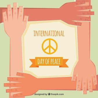 Fondo del día de la paz con manos en diseño plano