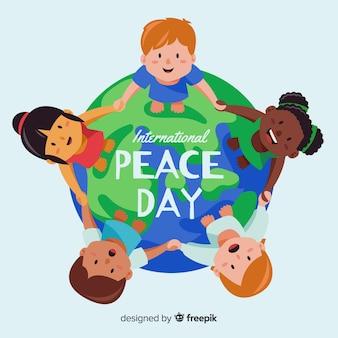 Fondo del día de la paz niños tomados de la mano en todo el mundo