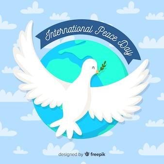 Fondo del día de la paz con paloma blanca