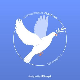 Fondo del día de la paz con una paloma en diseño plano