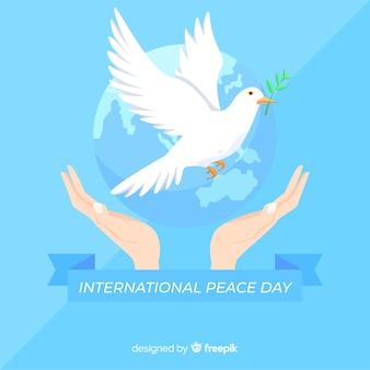 Fondo del día de la paz con paloma en diseño plano