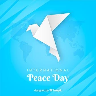 Fondo del día de la paz con una paloma en origami