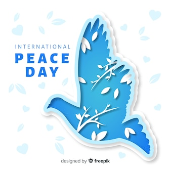 Fondo del día de la paz con paloma de papel