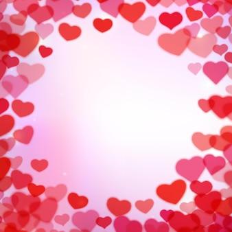 Fondo del día de san valentín con corazones tiernos borrosos dispersos