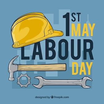 Fondo del día del trabajador con casco y herramientas