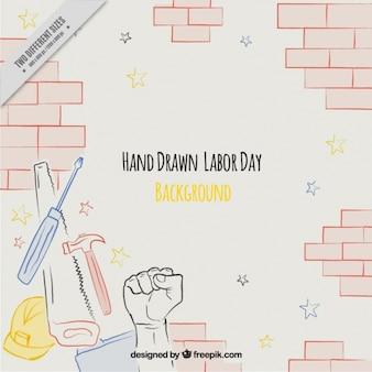 Fondo del día del trabajo con pared de ladrillos y herramientas dibujadas a mano
