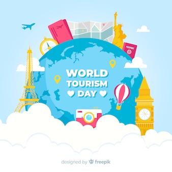 Fondo de día del turismo con mundo y monumentos en diseño plano