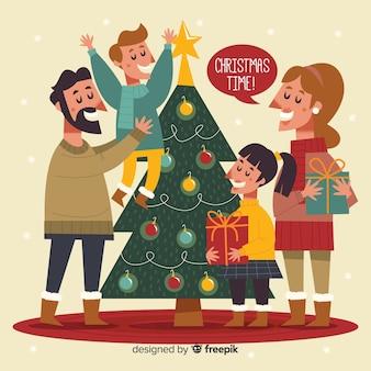 Fondo dibujado a mano familia decorando árbol de navidad