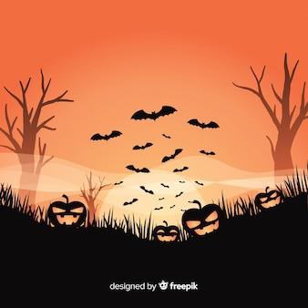 Fondo con diseño de halloween con calabazas escalofriantes
