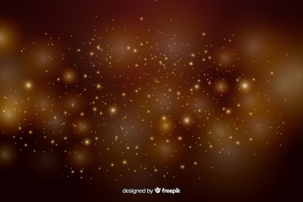Fondo dorado con partículas doradas