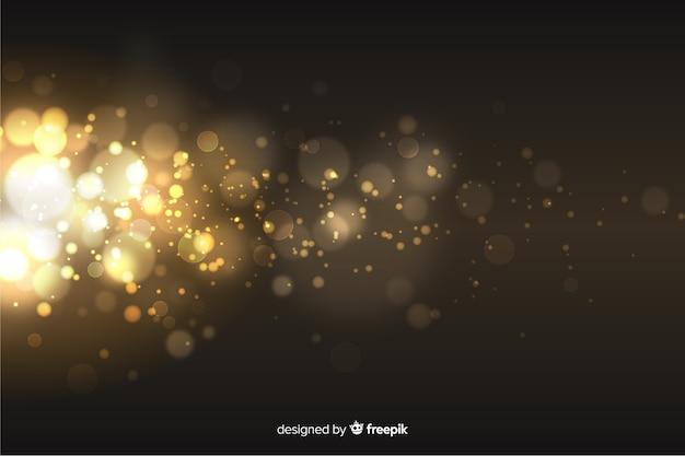 Fondo dorado de partículas estilo bokeh