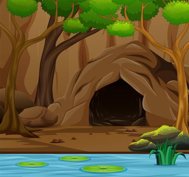 Fondo de escena de la naturaleza con cueva y el pantano.
