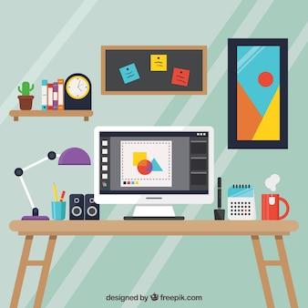 Fondo de espacio de trabajo de diseño gráfico con escritorio y herramientas