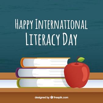 Fondo de feliz día de la alfabetización con libros y manzana