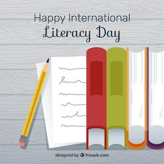Fondo de feliz día internacional de la alfabetización con libros y lápiz