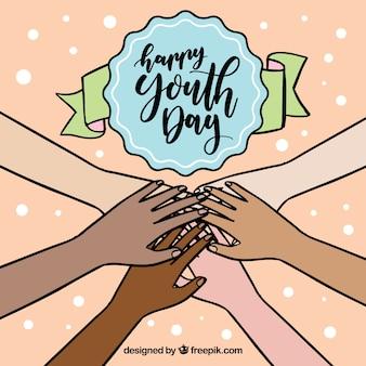Fondo de feliz día de la juventud con manos unidas