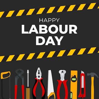 Fondo de feliz día del trabajo de 1 de mayo con herramientas de trabajo