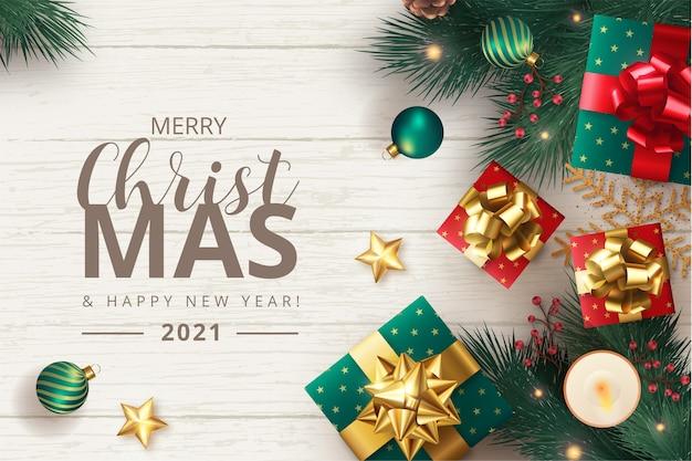 Fondo de feliz navidad con adornos y regalos realistas