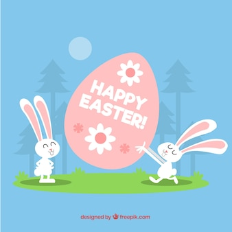 Fondo de feliz pascua con conejitos y huevo