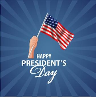 Fondo feliz de presidentes day con la bandera que agita en la mano del hombre.