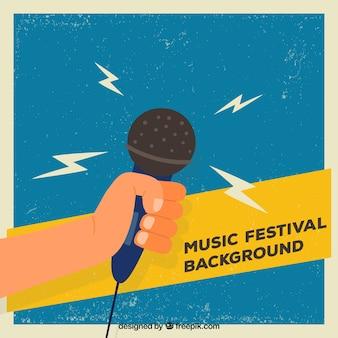 Fondo de festival de música con mano sosteniendo un micrófono