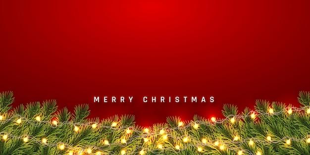 Fondo festivo de navidad o año nuevo. ramas de abeto de navidad con guirnalda ligera. antecedentes de vacaciones.