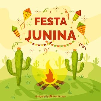 Fondo de fiesta junina con fogata y cactus