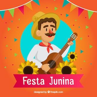 Fondo de fiesta junina con hombre y guitarra