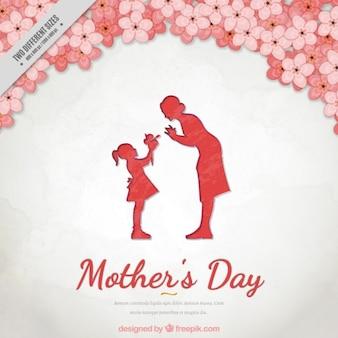 Fondo floral del día de la madre con una bonita escena entre madre e hija