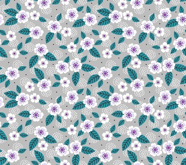 Fondo floral vintage. patrón sin fisuras con pequeñas flores sobre un fondo gris.