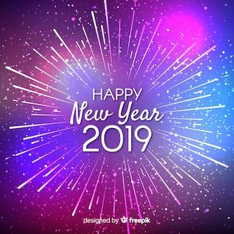 Fondo de fuegos artificiales de año nuevo 2019 dorado
