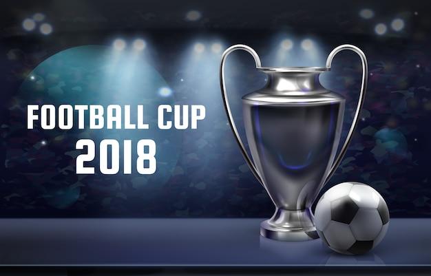 Fondo de fútbol con copa de plata y pelota en el estadio con foco y lugar para texto