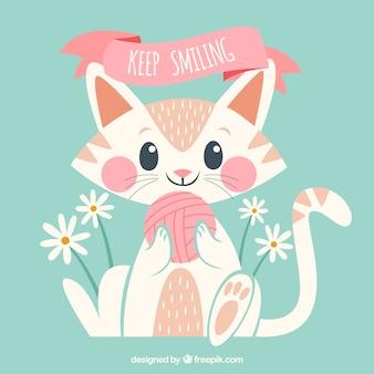 Fondo de gatito adorable con ovillo